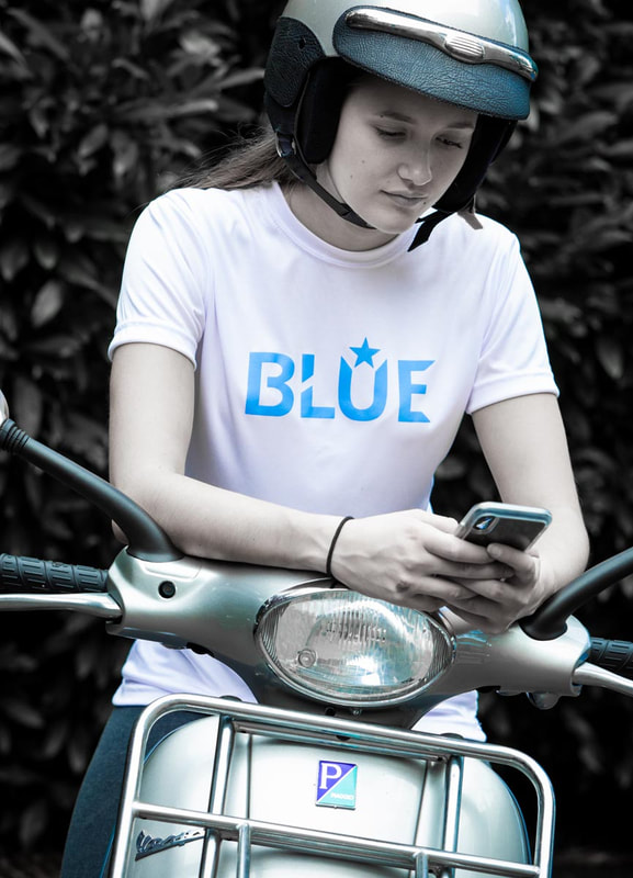 Woman in BLUE Brand T-Shirt on Motor Scooter